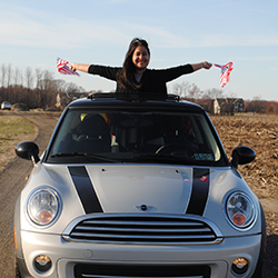 Lucero riding in Mini Cooper with Flags